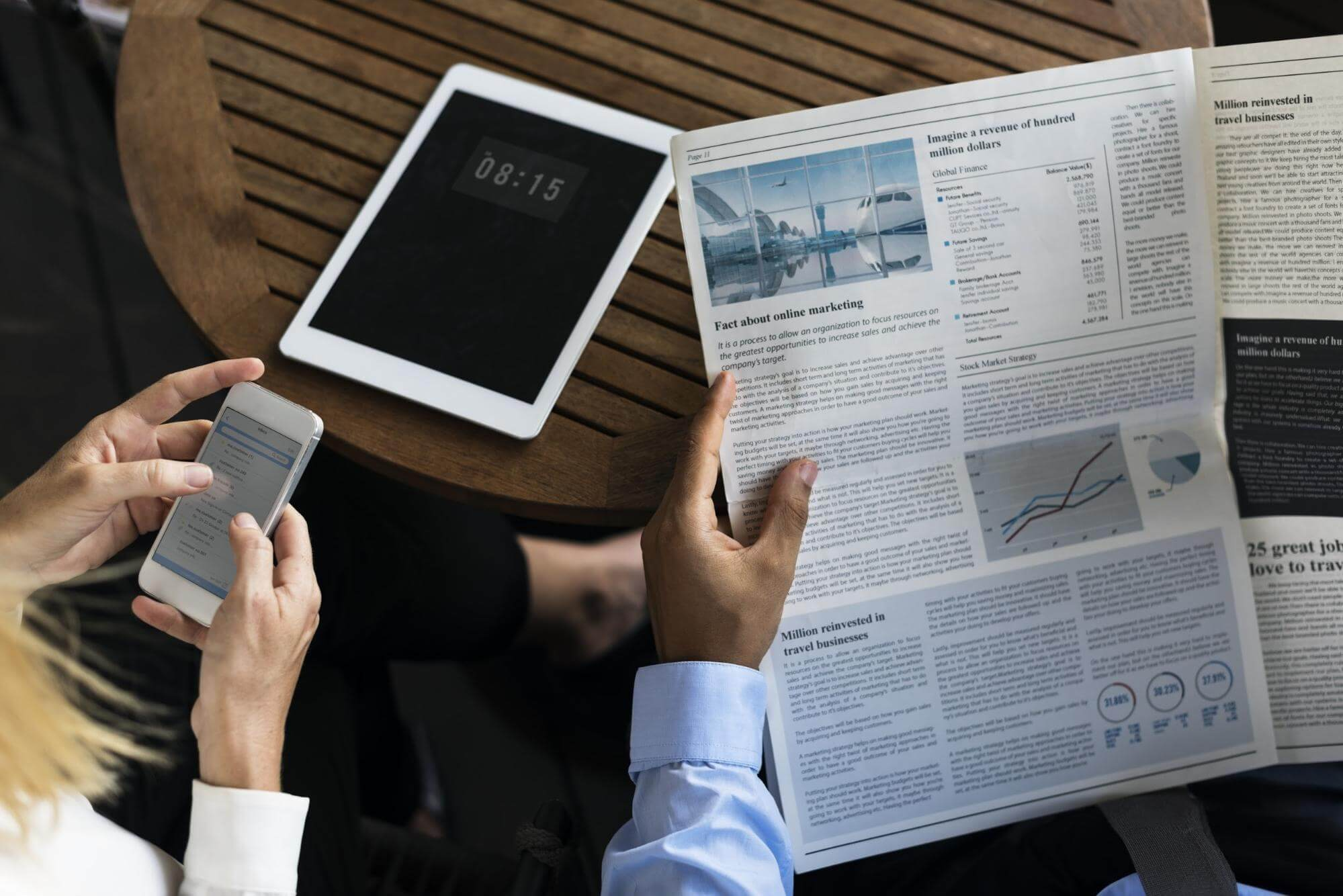 newspaper and smart devices