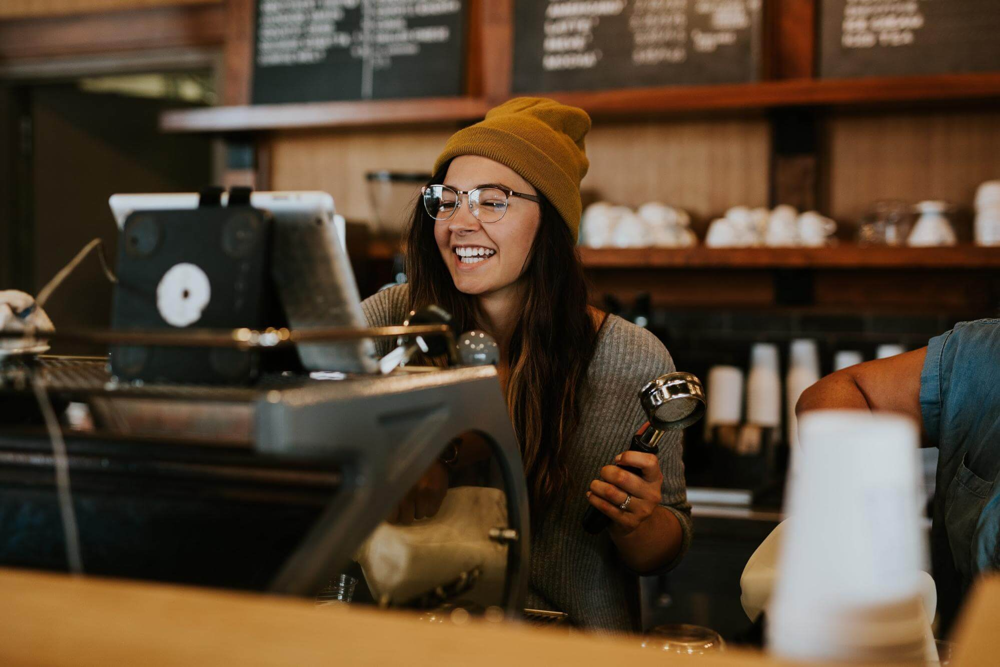 girl barista smiling at a coffee shop